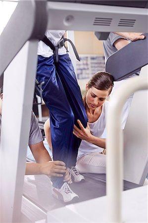 rehabilitation - Physical therapists guiding man on treadmill Stock Photo - Premium Royalty-Free, Code: 6113-08521493