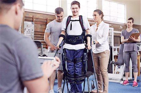 rehabilitation - Physical therapists guiding man walking Stock Photo - Premium Royalty-Free, Code: 6113-08521490