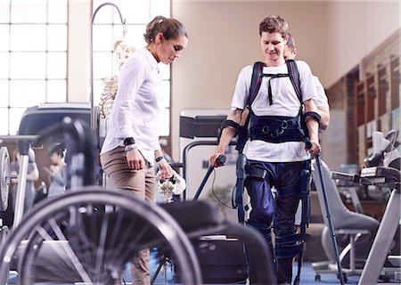 rehabilitation - Man with forearm crutches receiving physical therapy Stock Photo - Premium Royalty-Free, Code: 6113-08521492