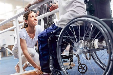 rehabilitation - Physical therapist preparing man in wheelchair Stock Photo - Premium Royalty-Free, Code: 6113-08521496