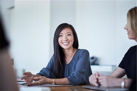 Smiling businesswoman in meeting Stock Photo - Premium Royalty-Free, Code: 6113-08521403