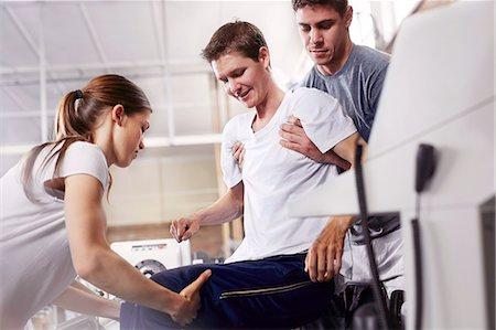 rehabilitation - Physical therapists lifting man Stock Photo - Premium Royalty-Free, Code: 6113-08521501