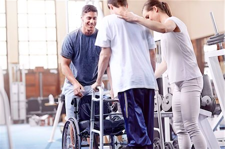 Physical therapists helping man with walker Stock Photo - Premium Royalty-Free, Code: 6113-08521502