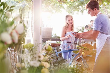 florist - Florist with digital tablet talking to customer with bicycle Stock Photo - Premium Royalty-Free, Code: 6113-08536178