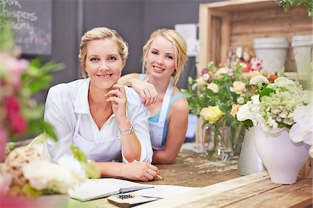 florist - Portrait smiling florists in flower shop Stock Photo - Premium Royalty-Free, Code: 6113-08536204