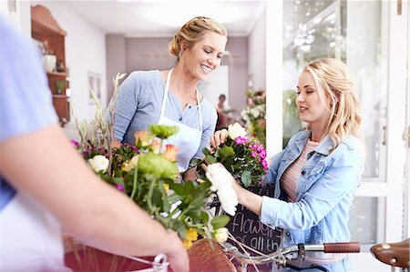 florist - Florist helping woman pick out flowers in flower shop Stock Photo - Premium Royalty-Free, Code: 6113-08536209