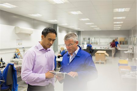 filipino (male) - Manager and engineer looking at clipboard in steel factory office Stock Photo - Premium Royalty-Free, Code: 6113-08655246
