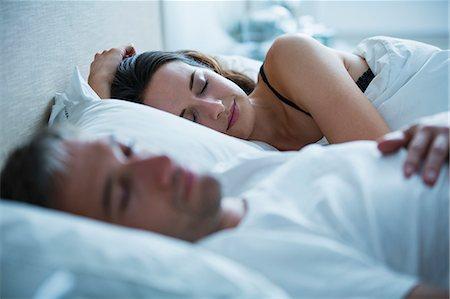 Serene couple sleeping in bed Stock Photo - Premium Royalty-Free, Code: 6113-08655467