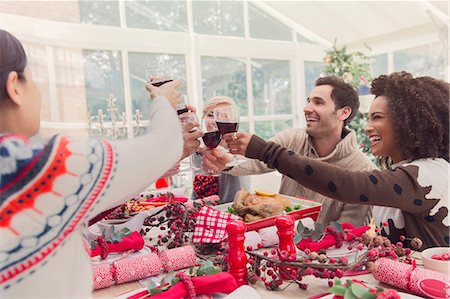 southeast asian ethnicity - Friends toasting wine glasses at Christmas table Stock Photo - Premium Royalty-Free, Code: 6113-08659553
