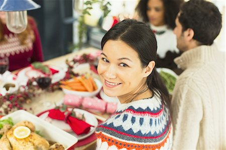Portrait smiling woman at Christmas dinner Stock Photo - Premium Royalty-Free, Code: 6113-08659587