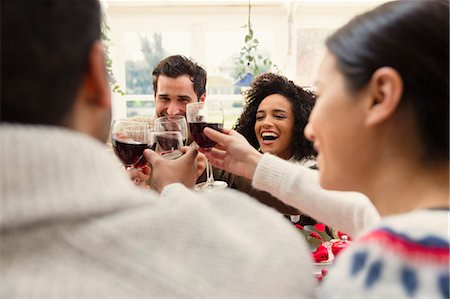 southeast asian ethnicity - Enthusiastic friends toasting wine glasses at Christmas dinner Stock Photo - Premium Royalty-Free, Code: 6113-08659597