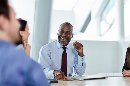 Laughing businessman enjoying meeting Stock Photo - Premium Royalty-Free, Code: 6113-08659669
