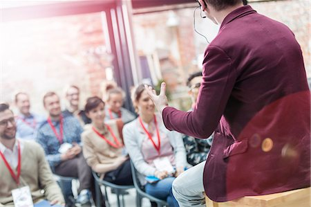 Man presenting to audience at technology conference Stock Photo - Premium Royalty-Free, Code: 6113-08698009