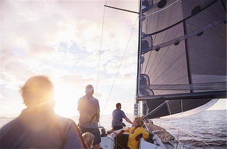 sailboat  ocean - Friends sailing on sunny ocean Stock Photo - Premium Royalty-Free, Code: 6113-08698141