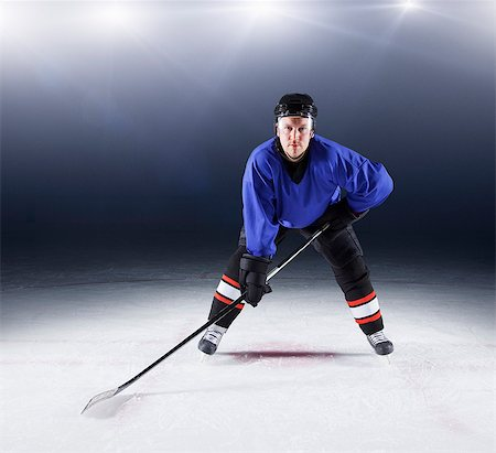 sports and hockey - Portrait confident hockey player on ice Stock Photo - Premium Royalty-Free, Code: 6113-08698153