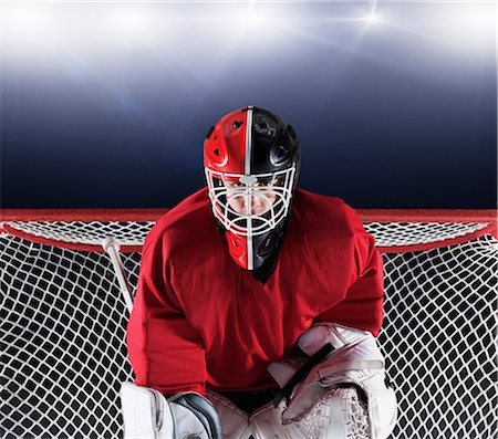 sports and hockey - Portrait determined hockey goalie protecting goal net Stock Photo - Premium Royalty-Free, Code: 6113-08698160