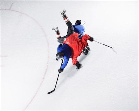 Hockey players colliding on ice Stock Photo - Premium Royalty-Free, Code: 6113-08698162