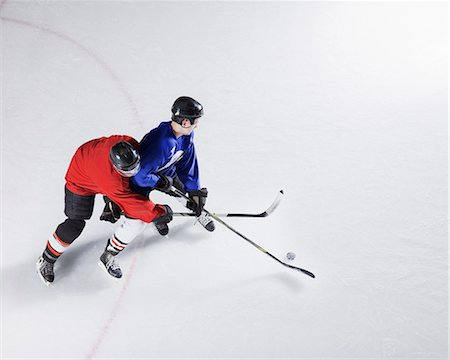 sports and hockey - Hockey players going for puck on ice Stock Photo - Premium Royalty-Free, Code: 6113-08698167