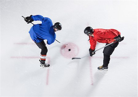Hockey opponents in opening face off Stock Photo - Premium Royalty-Free, Code: 6113-08698177