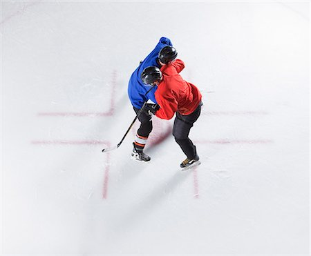 sports and hockey - Overhead view hockey opponents colliding Stock Photo - Premium Royalty-Free, Code: 6113-08698183