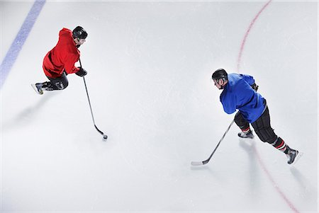 sports and hockey - Overhead view hockey opponents with puck Stock Photo - Premium Royalty-Free, Code: 6113-08698180