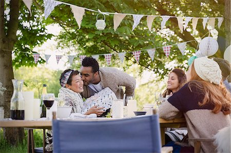 southeast asian ethnicity - Boyfriend kissing girlfriend with birthday gift at garden party table Stock Photo - Premium Royalty-Free, Code: 6113-08743488