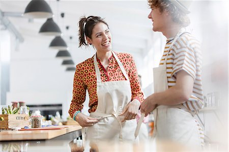 Couple enjoying cooking class in kitchen Stock Photo - Premium Royalty-Free, Code: 6113-08743614