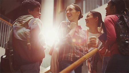 Smiling college students on stairway Stock Photo - Premium Royalty-Free, Code: 6113-08769645