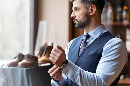 fashion - Businessman looking through window in menswear shop Stock Photo - Premium Royalty-Free, Code: 6113-08722340
