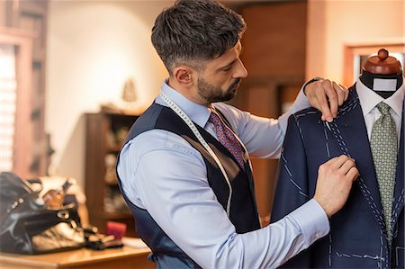 style - Tailor adjusting suit on dressmakers model in menswear shop Stock Photo - Premium Royalty-Free, Code: 6113-08722349