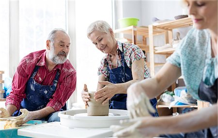 Senior couple using pottery wheel in studio Stock Photo - Premium Royalty-Free, Code: 6113-08722415