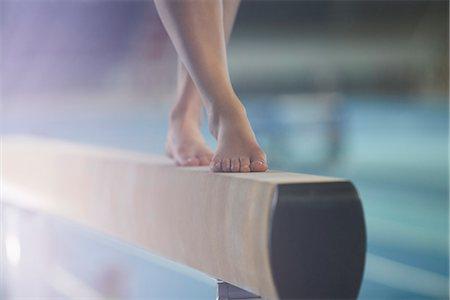 feet gymnast - Bare feet of female gymnast performing on balance beam Stock Photo - Premium Royalty-Free, Code: 6113-08805430