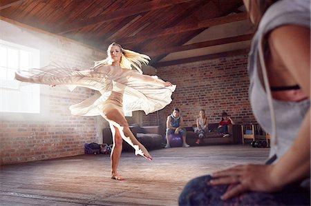 Graceful dancer dancing in studio Stock Photo - Premium Royalty-Free, Code: 6113-08805502