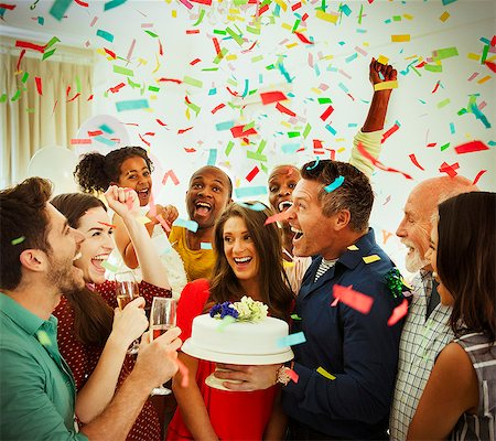 family image and confetti - Enthusiastic family with birthday cake throwing confetti Stock Photo - Premium Royalty-Free, Code: 6113-08805658