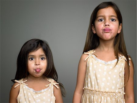 Sisters making faces Stock Photo - Premium Royalty-Free, Code: 6114-06589519