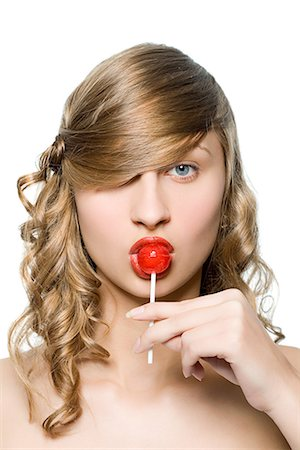 picture of a red lollipop - Young woman with a lollipop Stock Photo - Premium Royalty-Free, Code: 6114-06590142