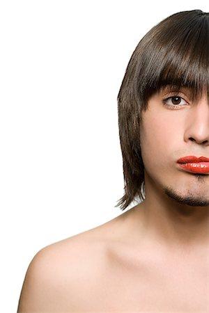 Young man wearing lipstick Stock Photo - Premium Royalty-Free, Code: 6114-06590153