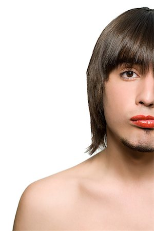 Young man wearing lipstick Stock Photo - Premium Royalty-Free, Code: 6114-06590153