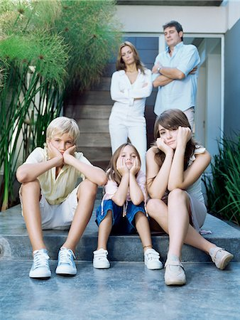 Family looking fed up Stock Photo - Premium Royalty-Free, Code: 6114-06590215
