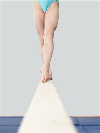feet gymnast - Legs of girl on a balance beam Stock Photo - Premium Royalty-Free, Code: 6114-06590479