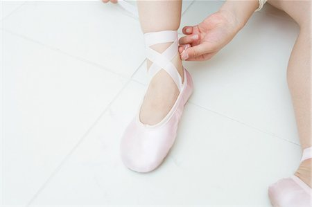 Putting on ballet slippers Stock Photo - Premium Royalty-Free, Code: 6114-06590950