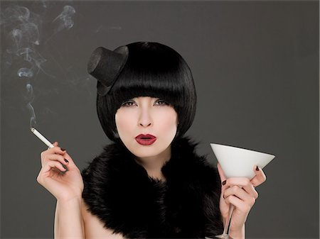 Woman smoking and drinking Stock Photo - Premium Royalty-Free, Code: 6114-06591038