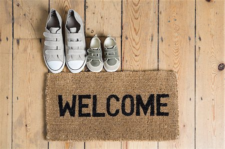 Training shoes and a welcome mat Stock Photo - Premium Royalty-Free, Code: 6114-06591901