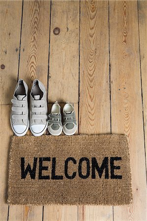 Training shoes and a welcome mat Stock Photo - Premium Royalty-Free, Code: 6114-06591909