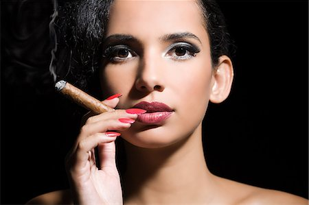 Woman smoking a cigar Stock Photo - Premium Royalty-Free, Code: 6114-06593598