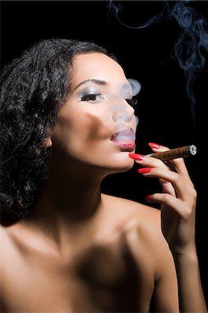 Beautiful woman smoking a cigar Stock Photo - Premium Royalty-Free, Code: 6114-06593645