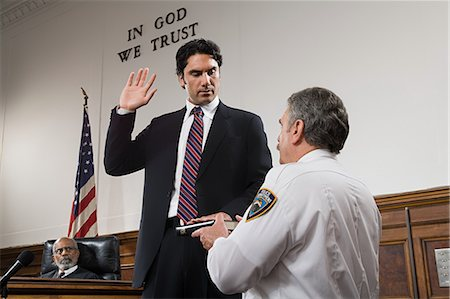 A witness swearing an oath Stock Photo - Premium Royalty-Free, Code: 6114-06593951