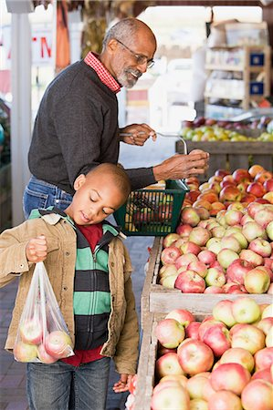 family apple orchard - A boy and his grandfather choosing apples Stock Photo - Premium Royalty-Free, Code: 6114-06594583