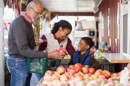 family apple orchard - Grandparents and their grandson choosing apples Stock Photo - Premium Royalty-Free, Code: 6114-06594617