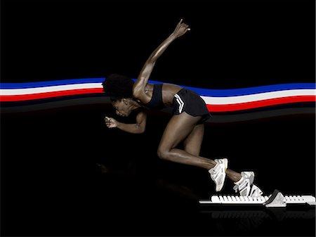 sprint - Athlete in starting blocks Stock Photo - Premium Royalty-Free, Code: 6114-06594946